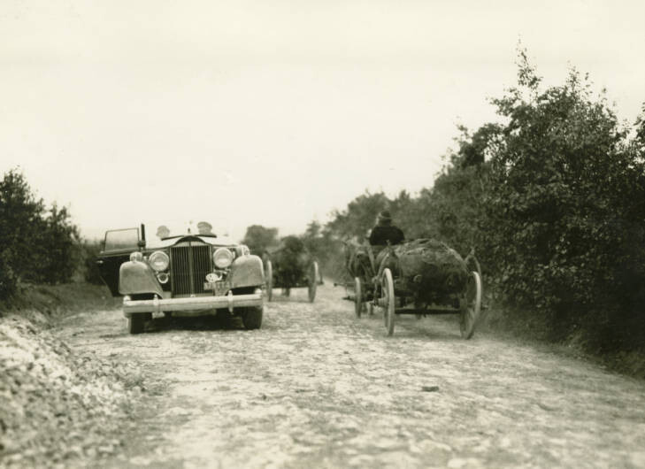 2 miles northwest of Nadworna. Barrels with petrol being taken from wells 14 km from here to refinery in Nadworna. On right, Packard car. September 22, 1934