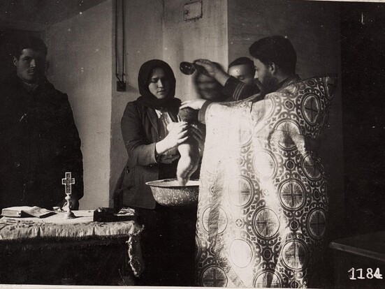 Traditional Ukrainian baptism showing Godparents