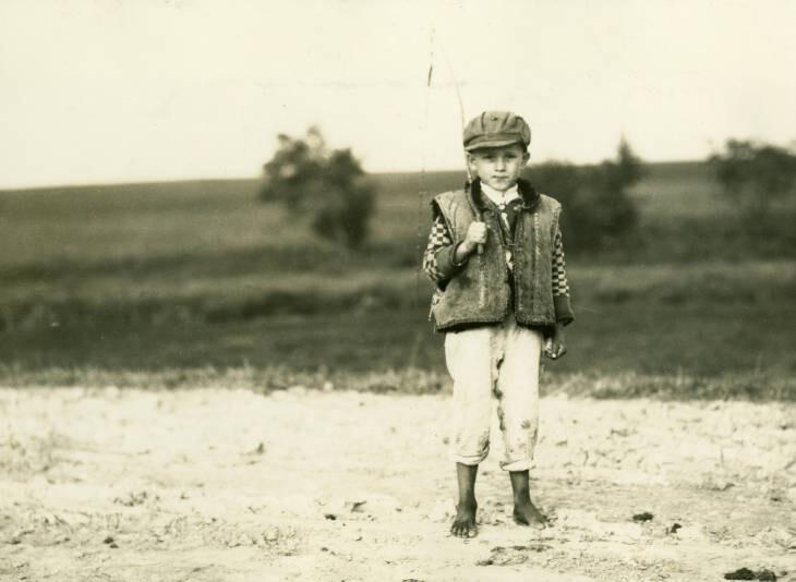 8 miles northeast of Gwozdziec. Peasant child on highway.