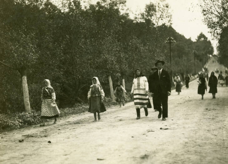 En route to Stryj to Dolina. Ruthenians on highway returning from market at Bolechow. On left woman in costume with bare legs and feet. Woman in center, in costume. September 21, 1934