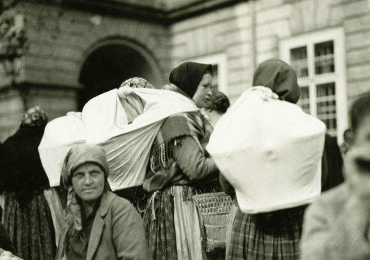 women with full bags at Lviv market in 1934 Ukraine