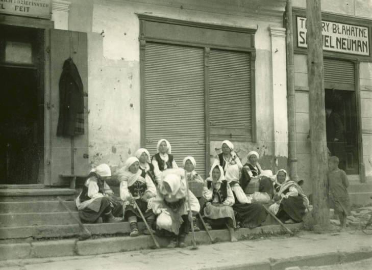 Women gather on steps in Staryi Sambor late afternoon after market in 1934 Ukraine